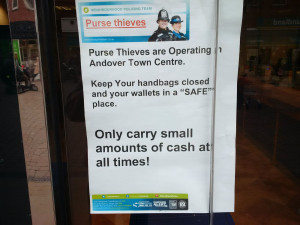 "Image of police ""warning"" on the perils of carrying ""too much"" cash."